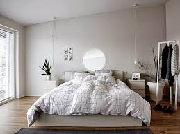 minimalist bedroom with neutral wall colors and hanging bedside