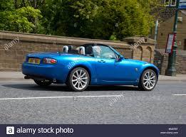 mazda convertible blue blue mazda mx5 sports car on going over a bridge stock photo