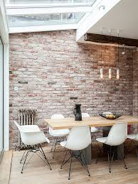 home trends design london loft dining table in walnut smart industrial dining room of london home with skylights