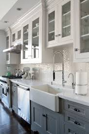 best 25 gray kitchen cabinets ideas only on pinterest grey white kitchen cabinets glass doors dark wood floors and white mini subway tile backsplash
