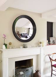 4 essential tips for hanging a round mirror above a fireplace