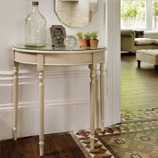 half moon narrow console table with glass top and painted with