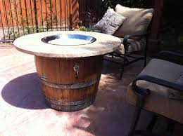 wine barrel fire table 23 genius ideas to repurpose old wine barrels into cool things