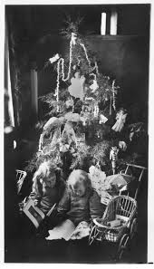 children around a christmas tree in russell county between 1870s