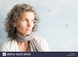 looking with grey hair middle aged woman with wavy grey hair and scarf looking to the