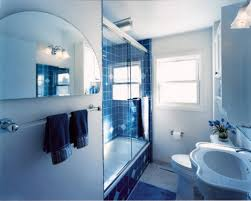white wood panelling to make light blue bathroom more airy