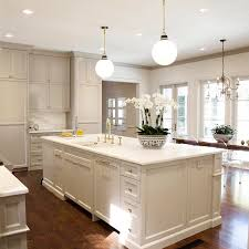 gray kitchen cabinets with white crown molding painting crown molding to match cabinets an exle in