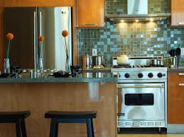 picking a kitchen backsplash hgtv stainless steel and stone this kitchen s light green tumbled marble backsplash