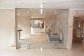 Interior Folding Glass Doors Frameless Glass Entrance Doors Modern Home House Design Ideas