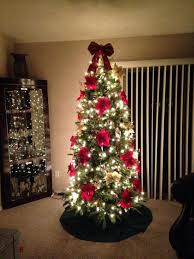 christmas tree with white lights and red bows red bow christmas decorations chritsmas decor