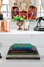 mint julep bar equestrian decor perfect for a derby party me kentucky derby party inspiration mint julep bar cart trophy cup vase woodford reserve