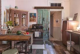 each kitchen uses an antique hutch to store dishes ceramic tiles