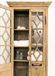 bathroom linen cabinet with glass doors ivory and gray bathroom with glass door linen cabinet for modern