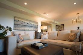 basement living room designs with white walls and wall art and
