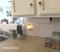 pictures of backsplashes in kitchen beadboard backsplash using wallpaper mom 4 real