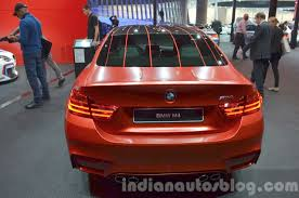 red bmw m4 bmw m4 in frozen red metallic rear at iaa 2015 indian autos blog