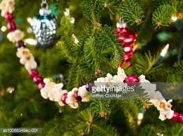 ornament and popcorn string on tree stock