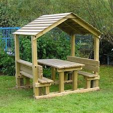 childrens wooden picnic table benches timber playground shelter a wooden shelter for children with