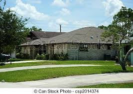 one level homes one level homes in florida with lawn and driveways angle stock