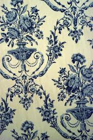 a detail of blue and white wallpaper reproduced from the original