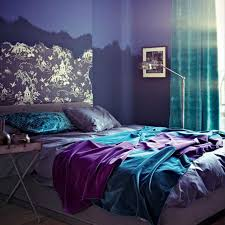 black furniture for black and purple bedroom with oval wall mirror