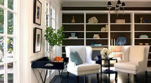 of black built ins bookshelves doily white walls paint color