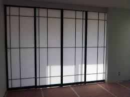 white room partition with black wooden frames connected by soft