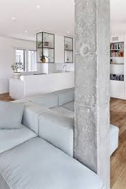 chic white interior and concrete material dominantly adorned the