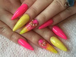 acrylic nails pink and yellow summer sculpted stiletto nails