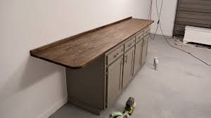 how to turn a base cabinet into a kitchen island how to upgrade your workbench with cabinets