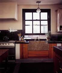 white kitchen cabinets with window trim black window
