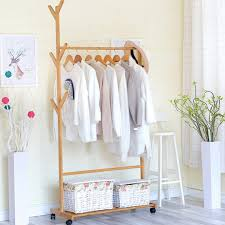minimalist scandinavian wooden clothes hanger rack home
