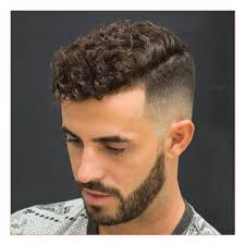 medium curly hairstyles for men or high fade with natural curly