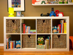 charming kids room with white wooden storage book shelves and 4
