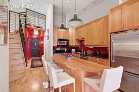 12 foot ceilings and a wall of windows at this 1 049m prospect 535 dean street prospect heights condo