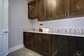 kitchen cabinets with grey walls laundry room interior features blue and grey walls framing brown
