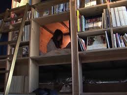 book and bed tokyo lets visitors sleep in bookshelves business
