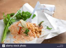 asian wrapping paper asia food fried noodles in food wrapping paper on the table stock