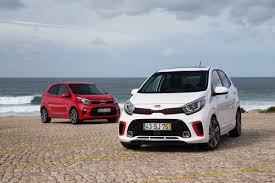 geneva kia reveals all new stinger picanto u0026 two hybrids