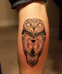 black ink owl on calf