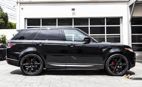 black land rover with black rims range rover sport
