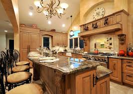 kitchen island with granite top and breakfast bar kitchen island granite chandelier light focal point tile