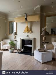 spacious living room large scale model airplane hung above fireplace in spacious living