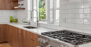 white kitchen cabinets with black subway tile backsplash is subway tile still timeless everything you need to