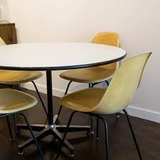 charles eames 650 dining table and four shell chairs by herman
