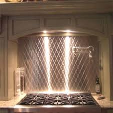 Custom Backsplashes - Cutting stainless steel backsplash