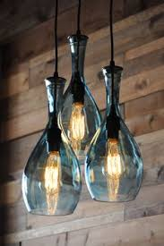 Diy Glass Bottle Chandelier More Diy Mason Jar Lighting Ideas Wall Sconces Lights And Mason