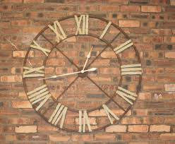 furniture oversized wall clock with roman numerals on brick wall