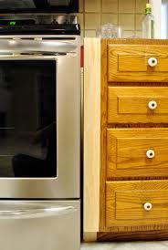 filling gaps between cabinets how to fix gaps in kitchen cabinets farmersagentartruiz com