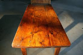 hand made thick top farm tables with brown cherry finish wood